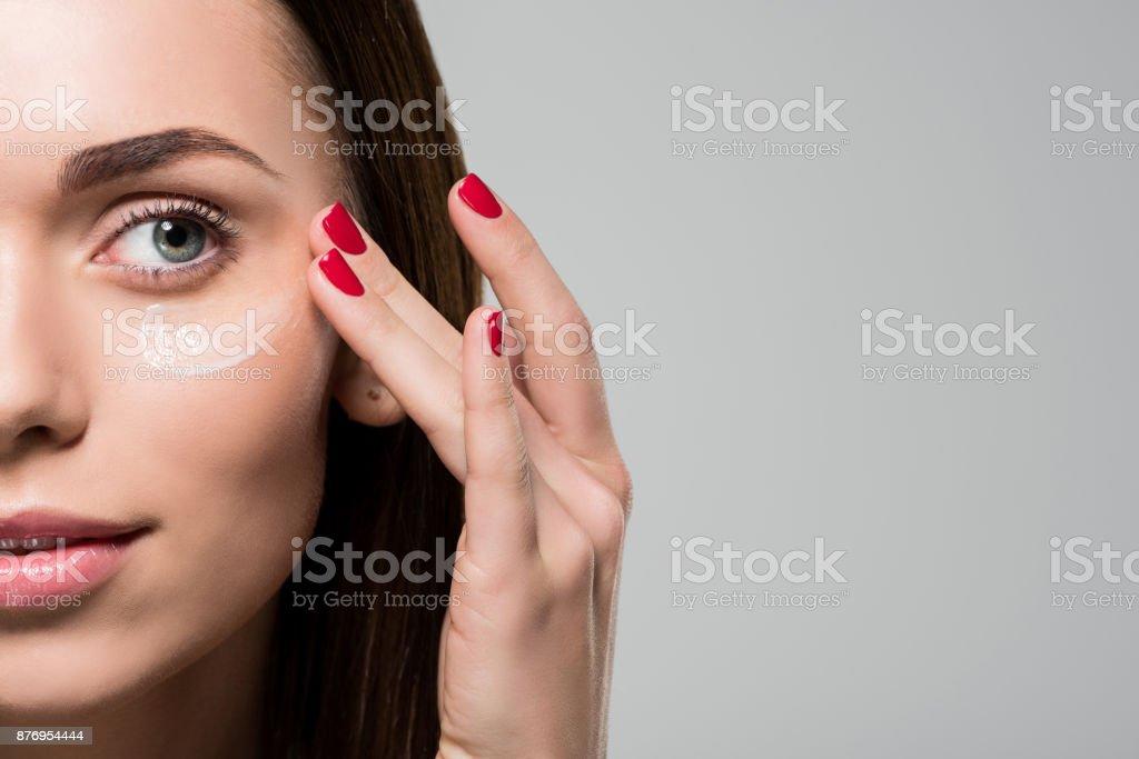 woman applying facial cream stock photo