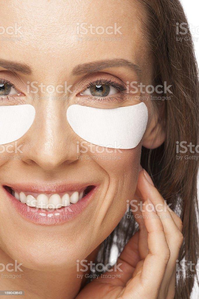 Woman applying gel eye mask royalty-free stock photo