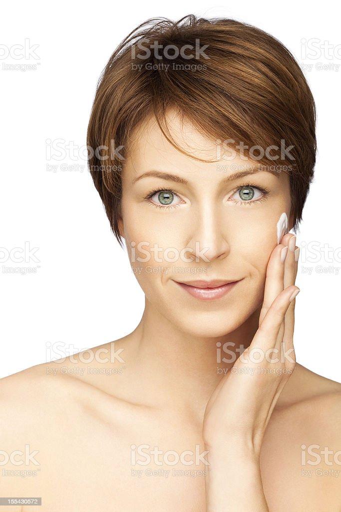 Woman Applying Her Beauty Cream royalty-free stock photo