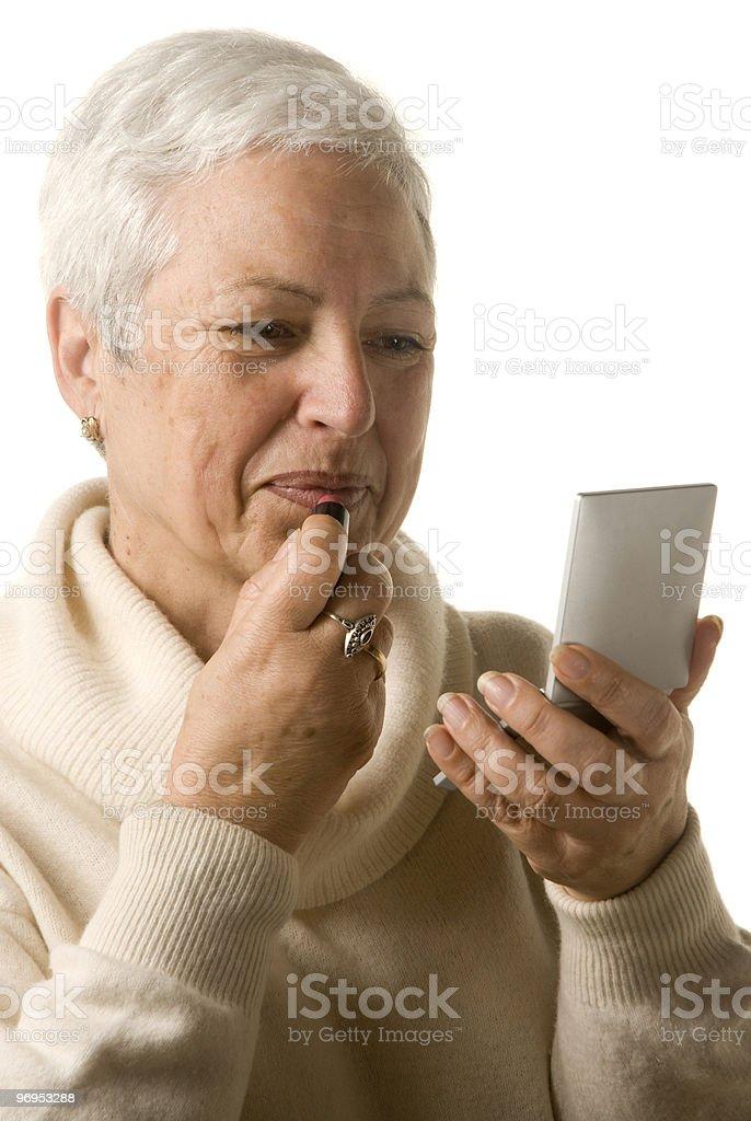 Woman applying lipstick royalty-free stock photo