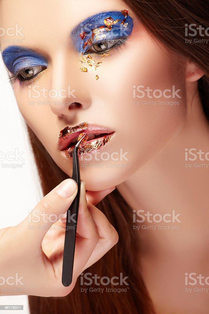 Woman applying make up royalty-free stock photo