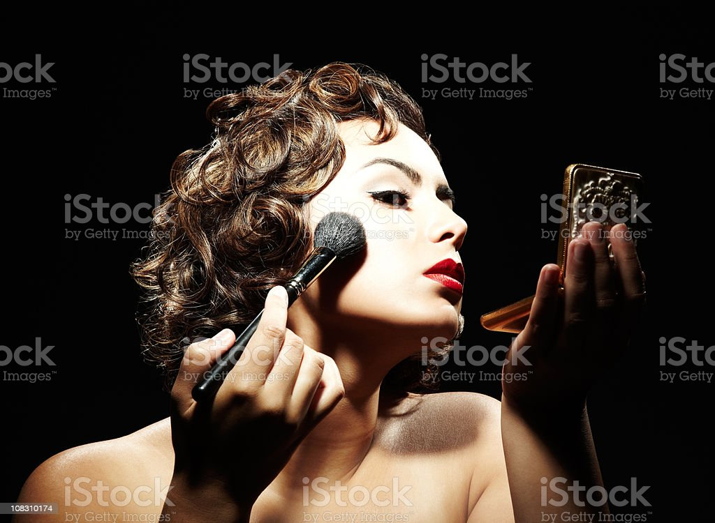Woman Applying Makeup royalty-free stock photo
