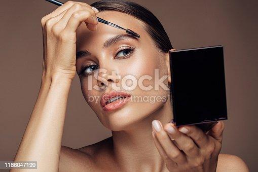 Woman applying make-up