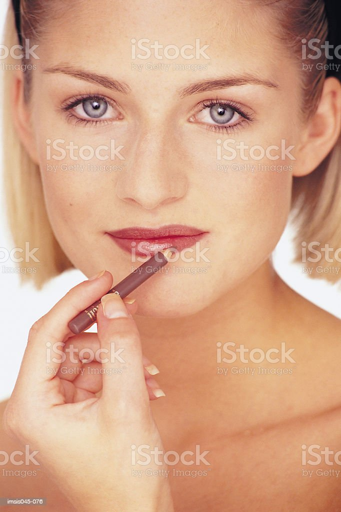 Woman applying make-up royalty-free stock photo