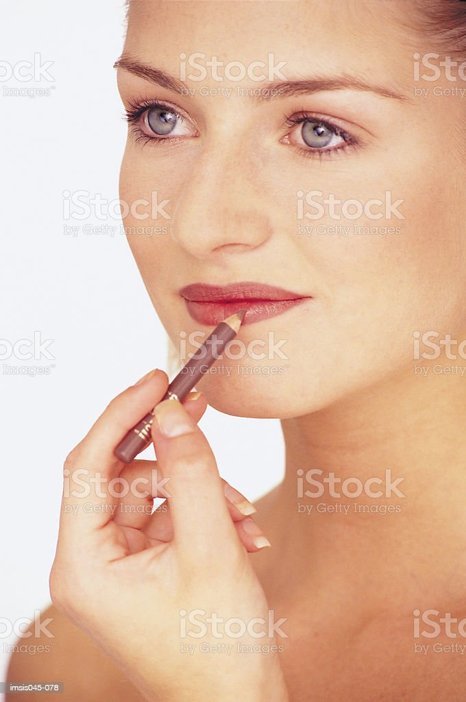 Woman applying make-up 免版稅 stock photo