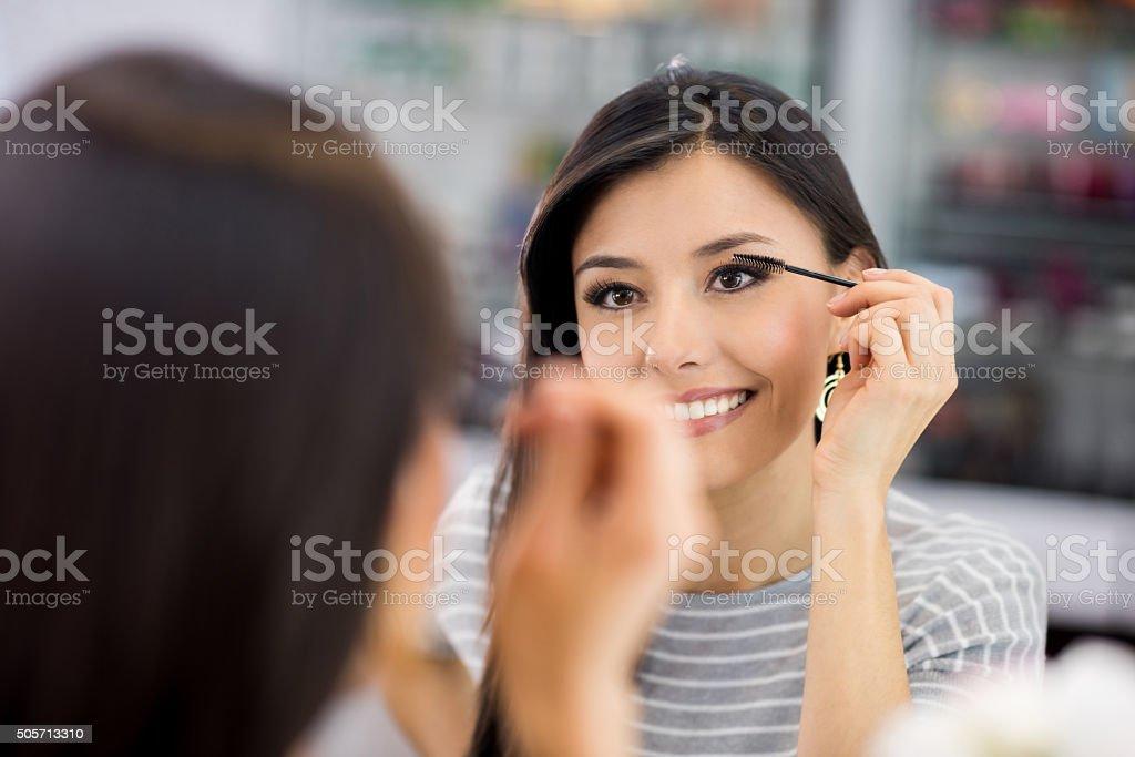 Woman applying mascara - makeup concepts stock photo