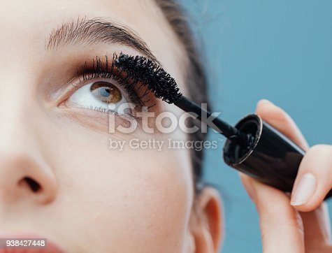 istock Woman applying mascara on her lashes 938427448