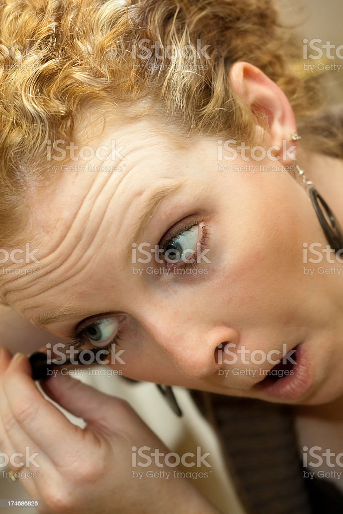 Woman applying mascara royalty-free stock photo
