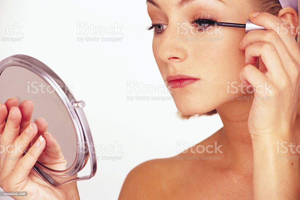 Woman applying mascara 免版稅 stock photo