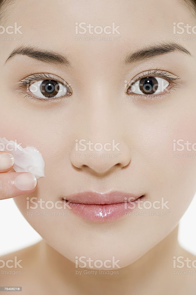 Woman applying moisturiser royalty-free stock photo