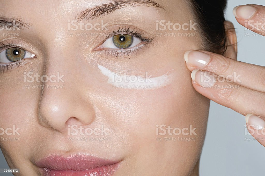 Woman applying moisturiser  Adults Only Stock Photo
