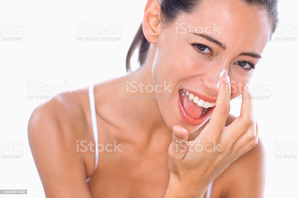 Woman applying moisturiser 免版稅 stock photo