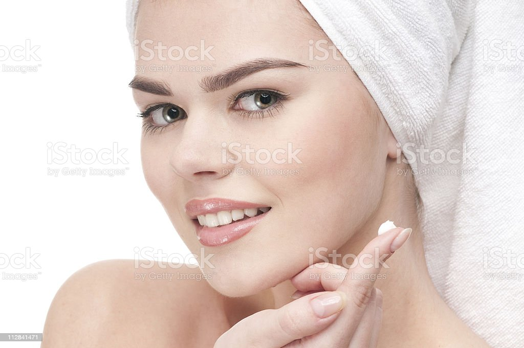 Woman applying moisturizer cream on face royalty-free stock photo