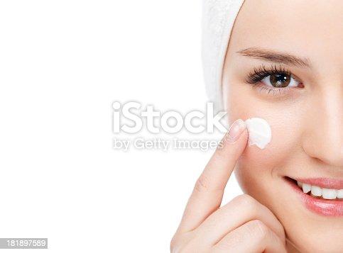 istock Woman applying moisturizer 181897589