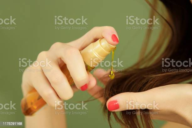 Woman Applying Oil On Hair Ends Split Hair Tips Dry Hair Or Sun Protection Concept Stock Photo - Download Image Now