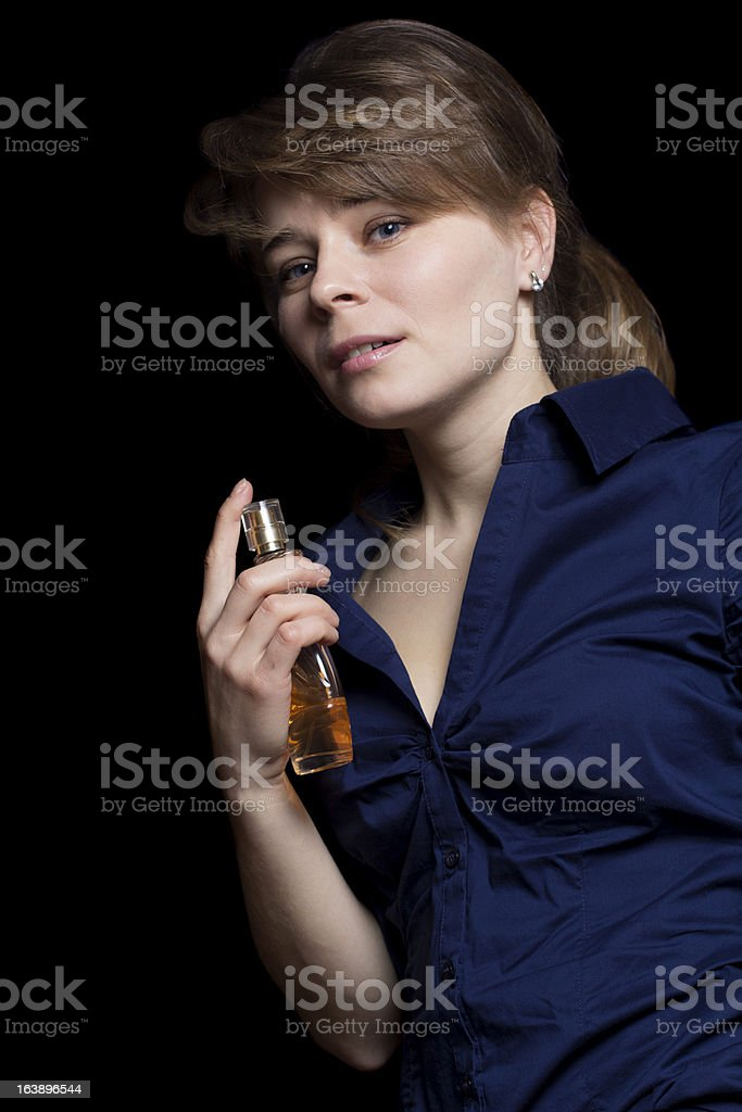 woman applying perfume royalty-free stock photo