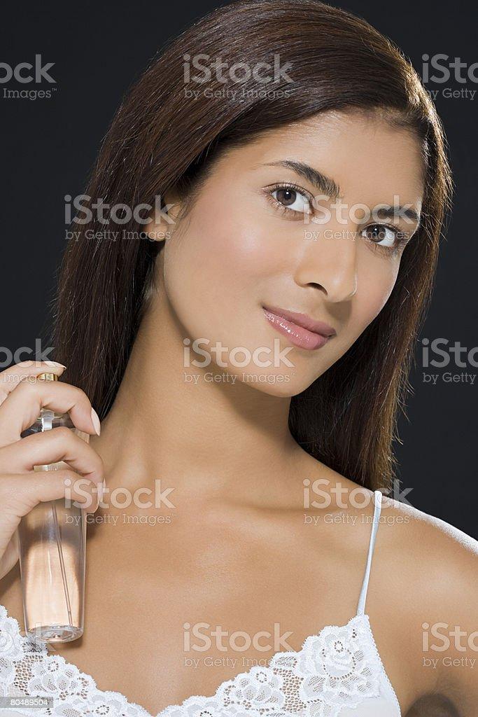 A woman applying perfume 免版稅 stock photo