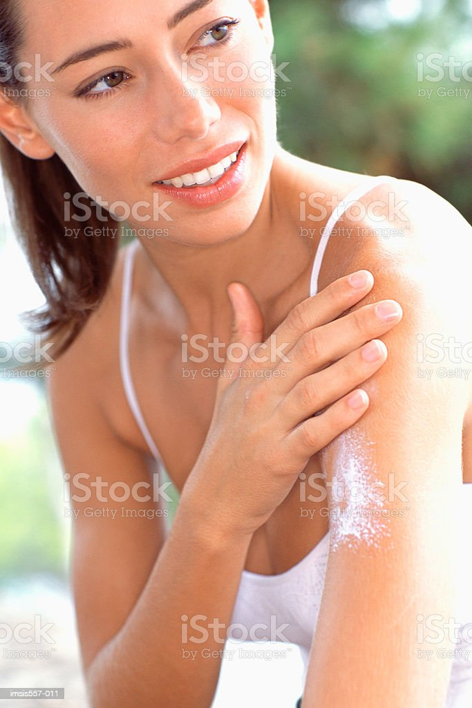 Woman applying sun cream royalty-free stock photo