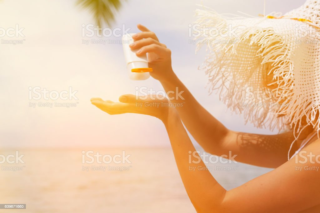 Woman applying sunblock protection stock photo