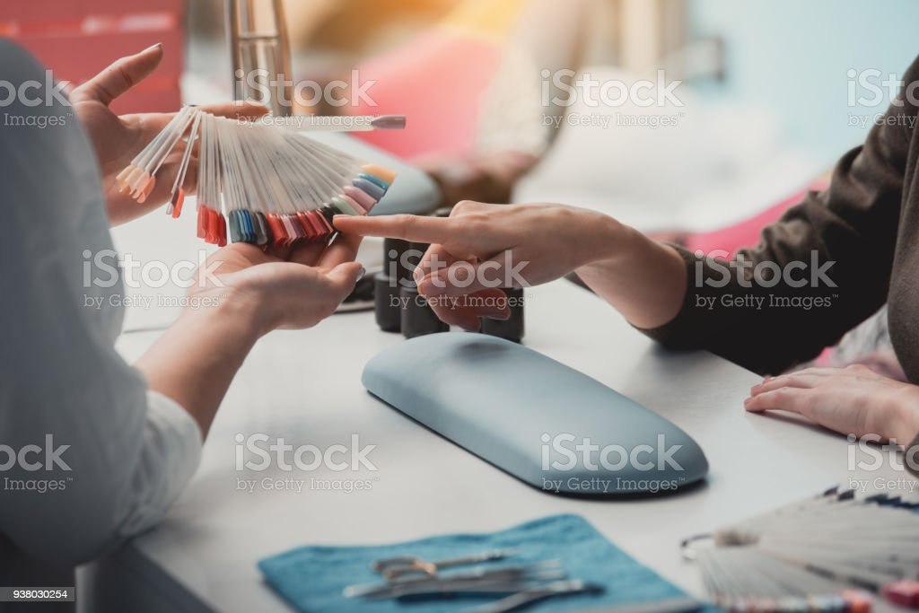 Woman arm demonstrating color for manicure stock photo