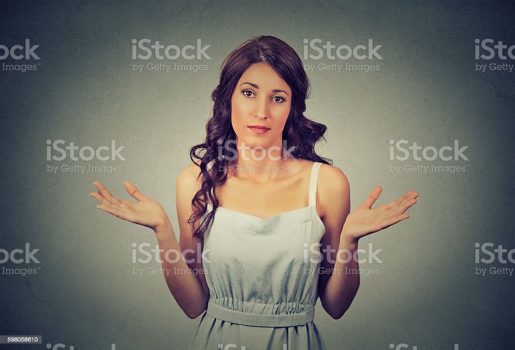 woman arms out shrugs shoulders I don't know stock photo