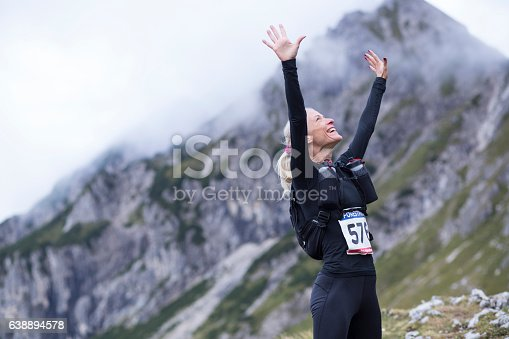 istock Woman arms raised 638894578