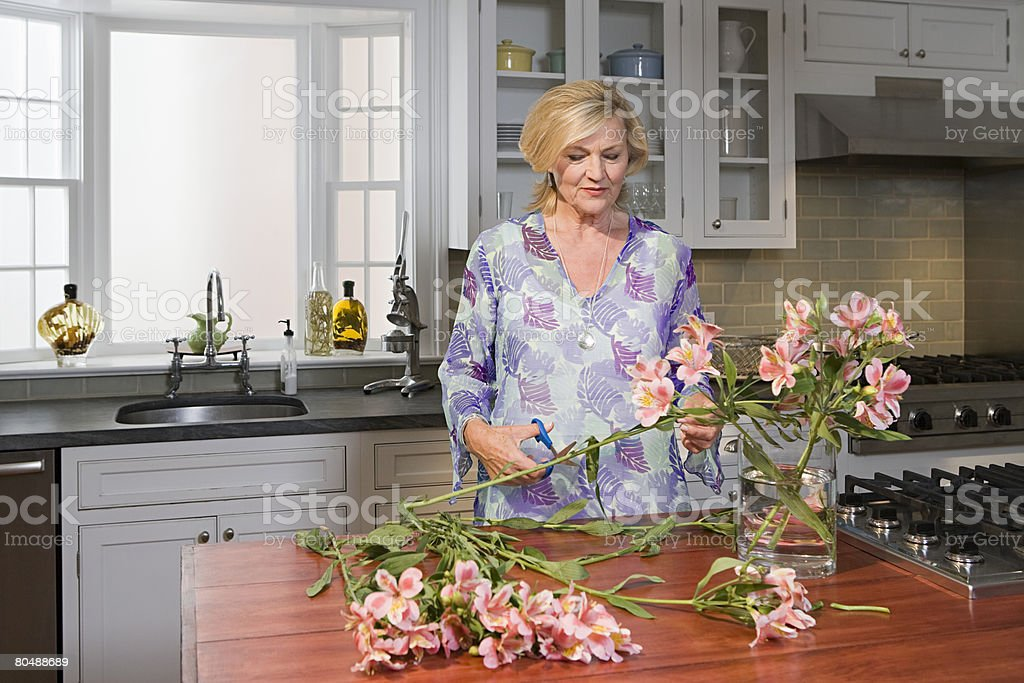 Woman arranging flowers royalty-free stock photo