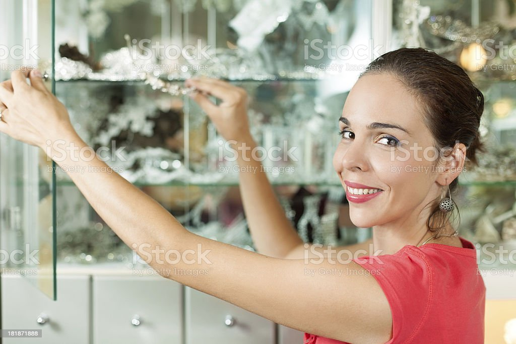 Woman arranging her accessories boutique. royalty-free stock photo