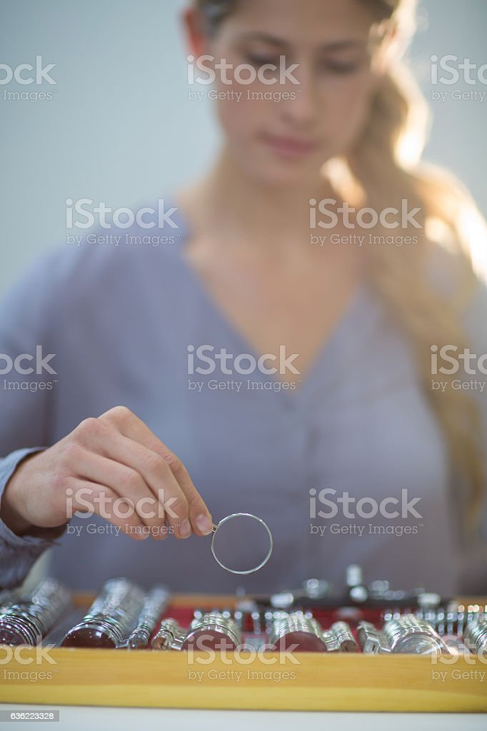 Woman arranging messbrille in tool box stock photo