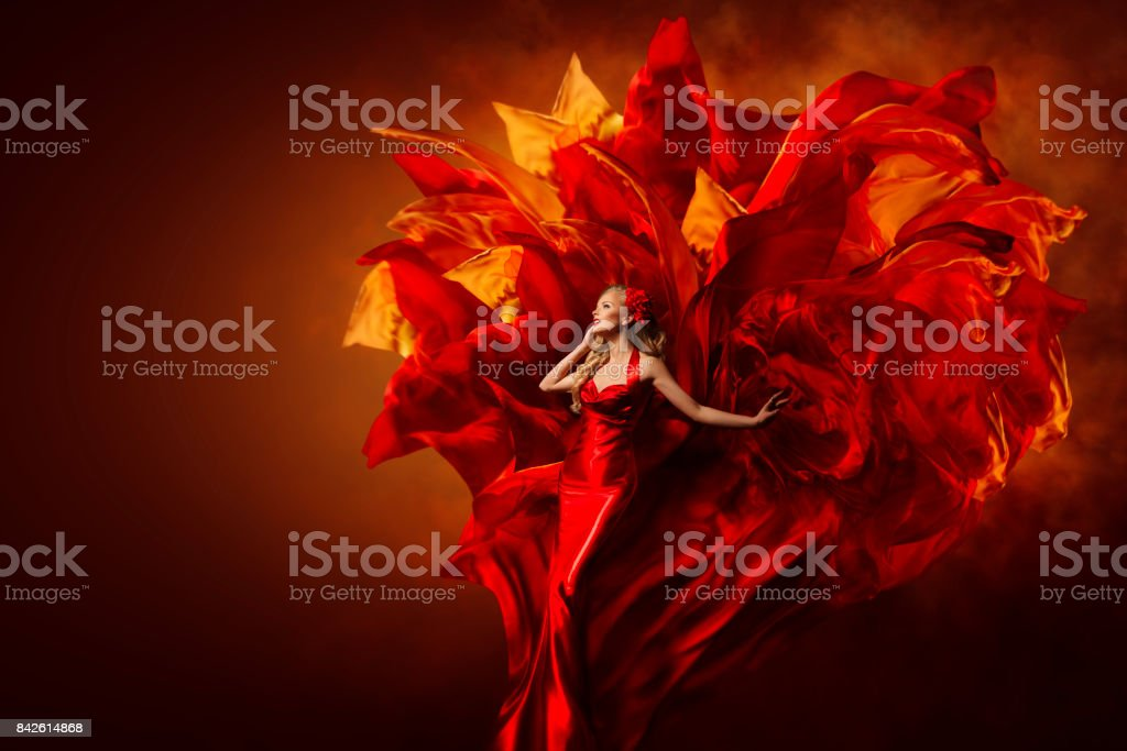 Woman Art Dress, Beautiful Fashion Model in Artistic Red Gown, Waving Flying Fabric Explosion stock photo