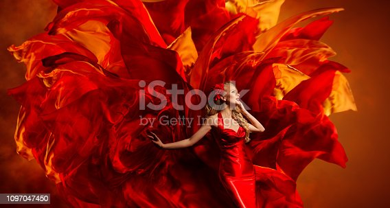 181894581 istock photo Woman Art Fantasy, Dancing Fashion Model on Abstract Red Fabric Color Explosion 1097047450