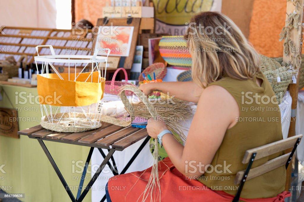 Woman artisan in a Spanish market stock photo