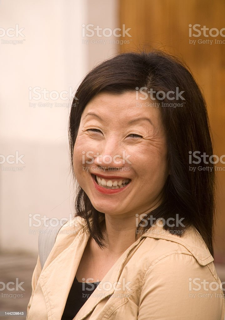 Woman, Asian Smiling broadly royalty-free stock photo