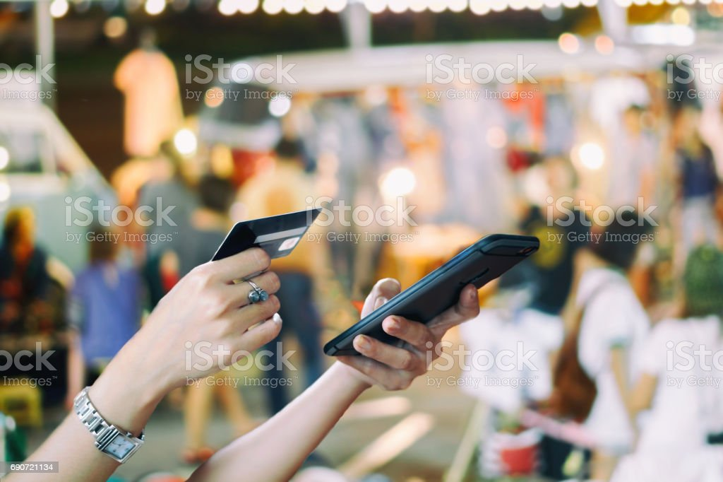 woman asian using smart phone and credit card shopping online , selective focus on hand stock photo