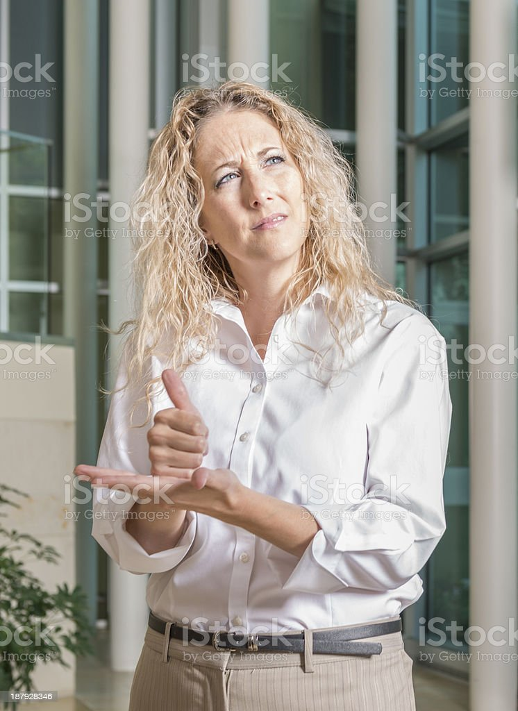 Woman asking for help using ASL royalty-free stock photo
