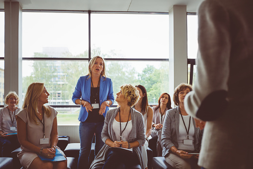 Woman Asking Question During Seminar Stock Photo - Download Image Now