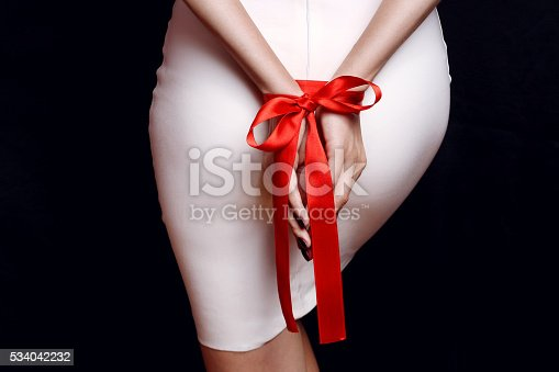 istock woman ass in white fitting dress 534042232
