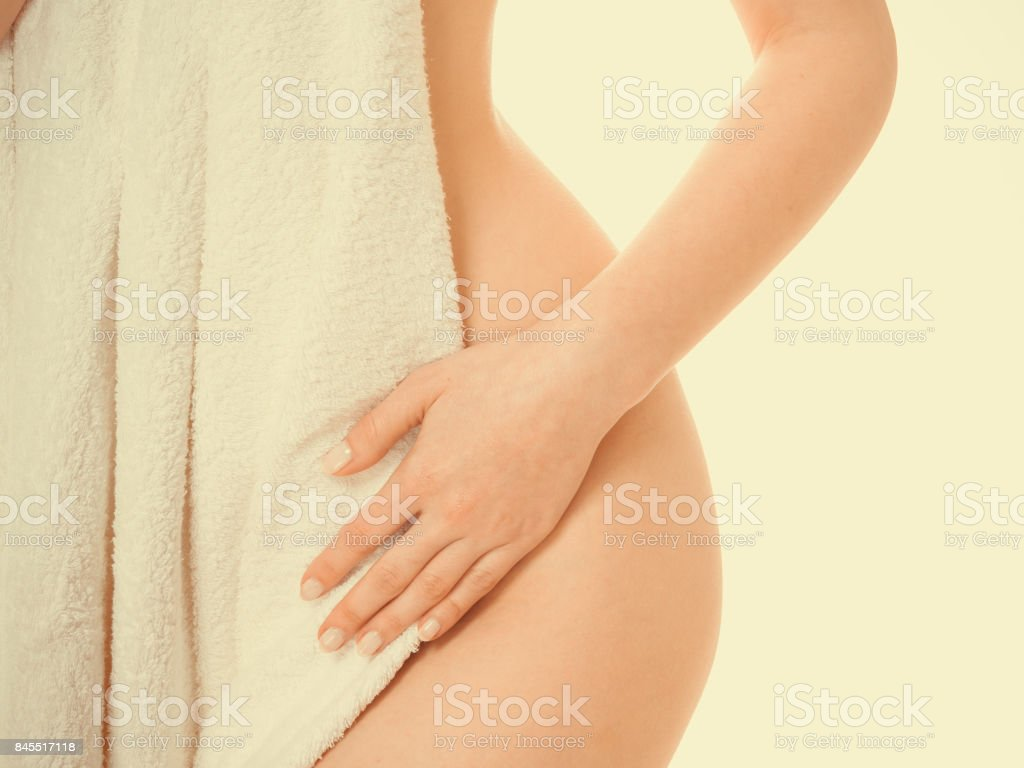 Woman ass vagin belly hide by towel. royalty-free stock photo