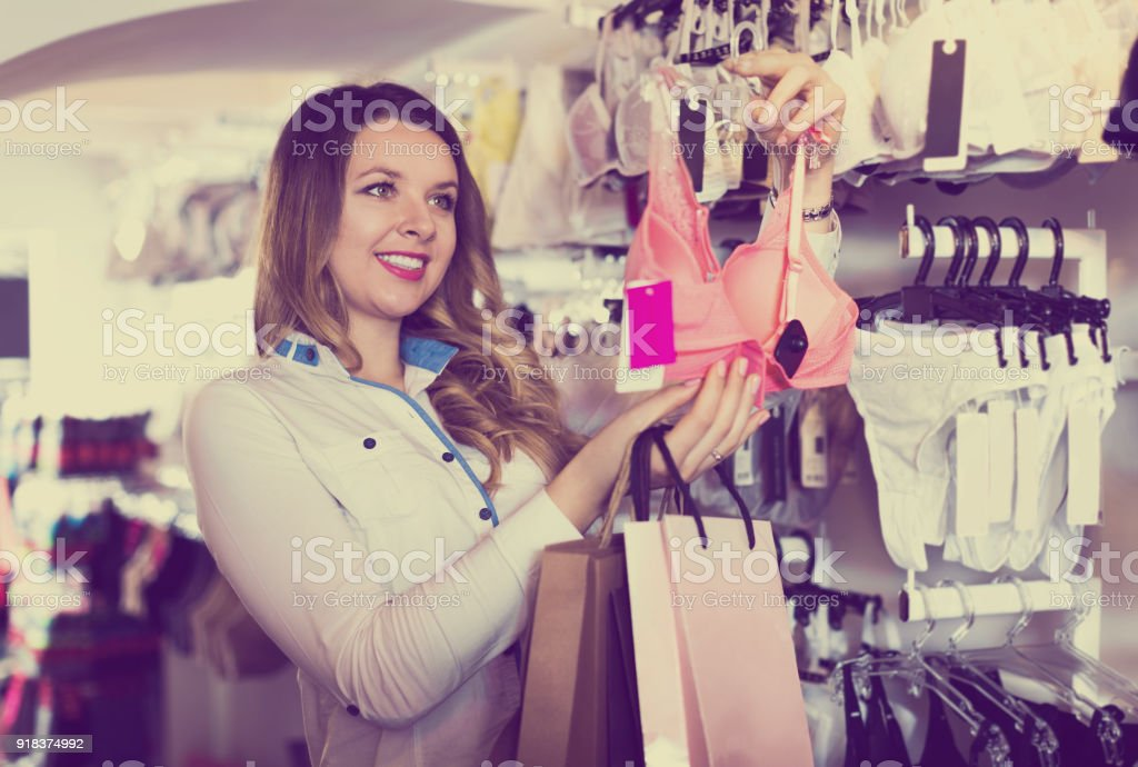 Woman assistant demonstrating numerous purchases stock photo