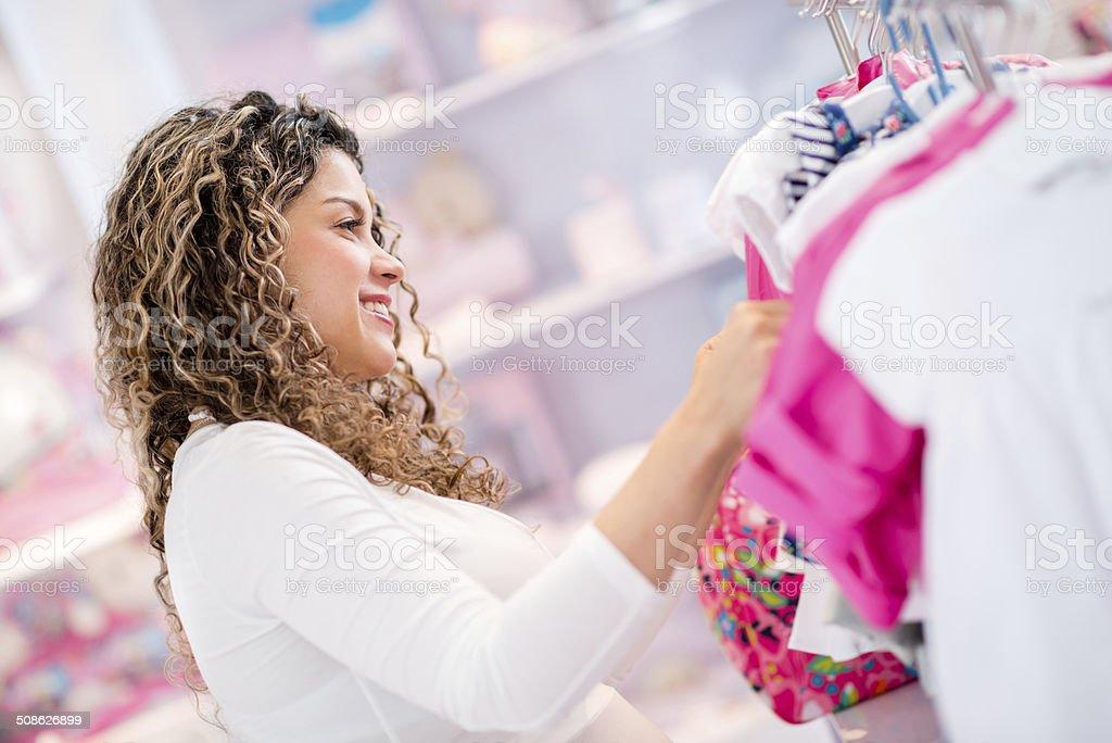 Woman at a baby shop stock photo