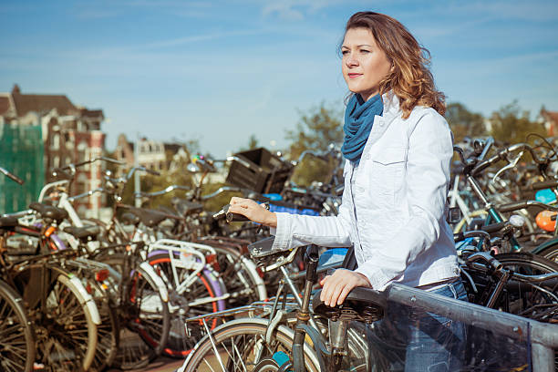 Woman  at a bike parking in Amsterdam 스톡 사진