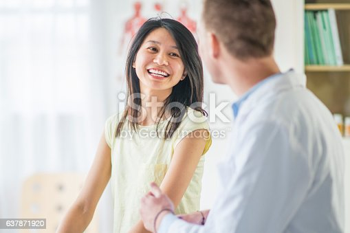 522625266istockphoto Woman at a Doctors Appointment 637871920