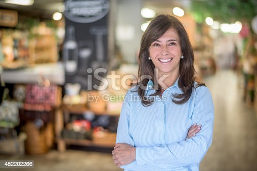 istock Woman at a food market grocery shopping 482202266
