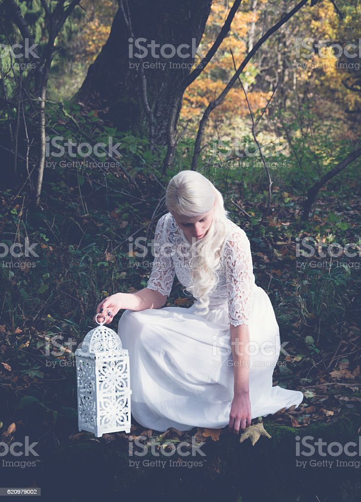 woman at a forest brook shore stock photo