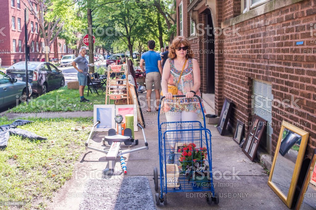 Woman at a garage sale in Chicago stock photo