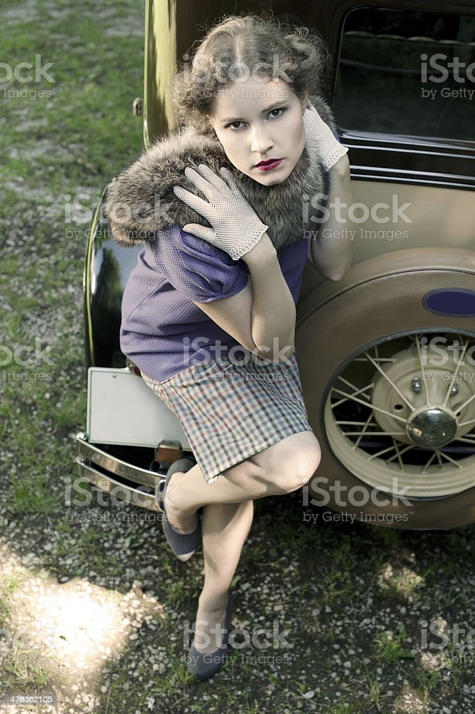 Woman at a Vintage Car 1930 Style royalty-free stock photo