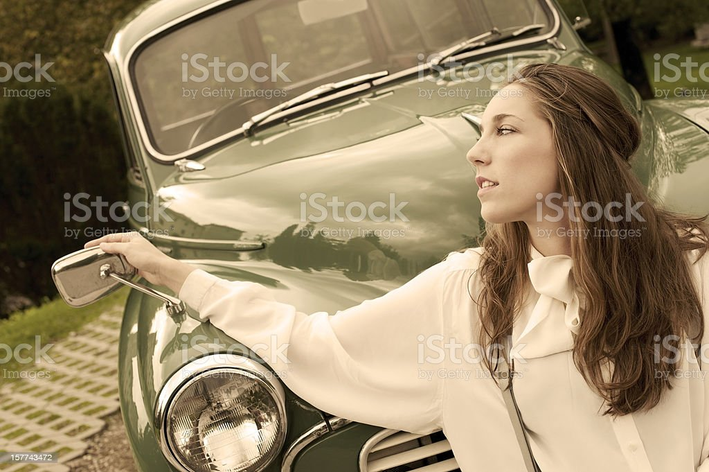 Woman at a Vintage Car royalty-free stock photo