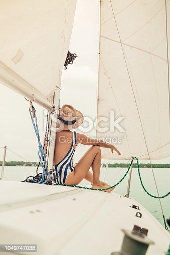 Woman at a vintage sailboat