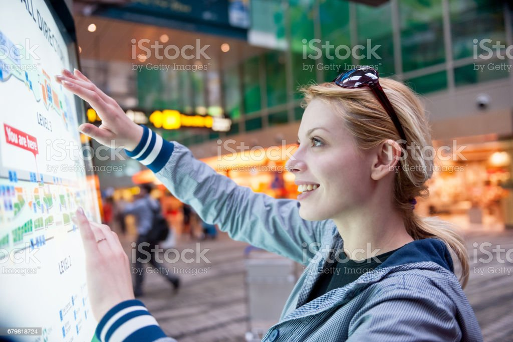 Woman at airport stock photo