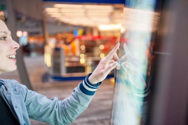 woman at airport - interactivity stock photos and pictures